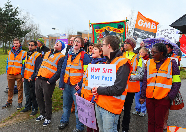 Junior doctors' picket with placard highlighting discrimination